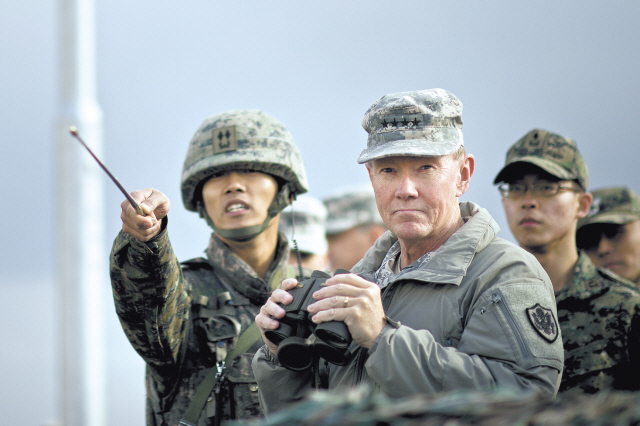 A South Korean officer briefs U.S. Joint Chiefs of Staff Chairman Martin Dempsey on points of interest at the Demilitarized Zone dividing the two Koreas on Nov. 11, 2012. (U.S. Department of Defense)