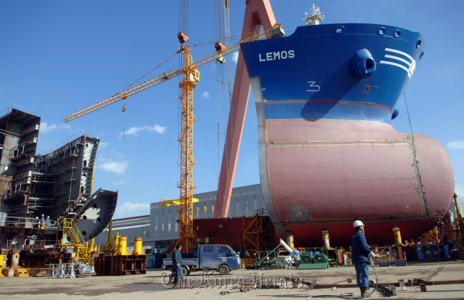 A tanker is under construction at the Hyundai Heavy Industries shipyard in Ulsan. (Bloomberg)