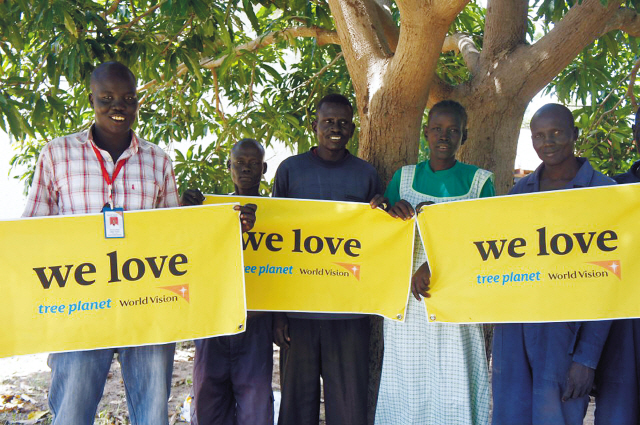 "Tree Planet Korea reveals photos of the 2NE1 forest in South Sudan, Africa, on Feb 14. Fans donated 1,210 mango trees to the village of Troj in honor of the group's ""New Evolution Seoul"" concert on July 2011. (Tree Planet)"