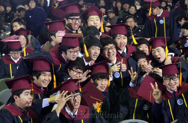 Seniors of Incheon Electronic Meister High School pose for a group photo after their graduation ceremony on Feb. 7. (Yonhap News)