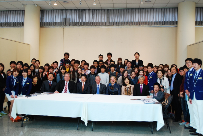 """Organizers including AMCHAM Korea chairman Pat Gaines (center seated) and students pose after attending the """"Innovation Camp"""" at Chungbuk National University in Cheongju on Friday. (Chungbuk National University)"""