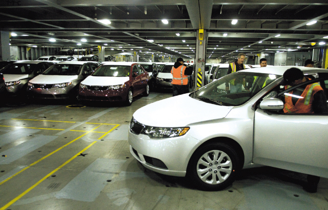 Workers unload Kia Motor vehicles at the National City Marine Terminal in California. (Bloomberg)