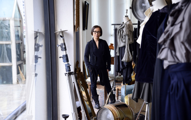Fashion designer Moon Young Hee poses for a photo at her studio in Bangbae-dong, Seoul, during an interview with The Korea Herald on Friday. (Park Hae-mook/The Korea Herald)