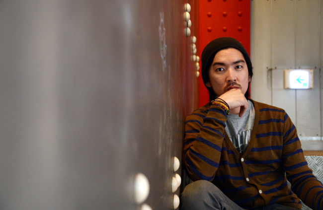 Hip-hop artist MYK, also known as Saltnpaper, poses at his studio label Dream Factory Club office in Sungnae-dong, Seoul. (Ahn Hoon/The Korea Herald)