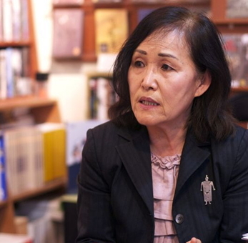 Korean-born American author Maija Rhee Devine speaks during a press conference at Seoul Selection Bookshop in Seoul on Wednesday. (Seoul Selection)
