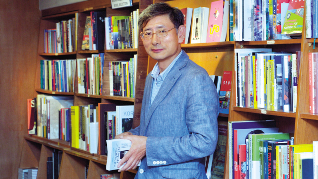 Hank Kim, CEO and president of Seoul Selection, poses for a photo during an interview with The Korea Herald at his bookstore in Sagan-dong, Seoul, on May 23.(Kim Myung-sub/The Korea Herald)