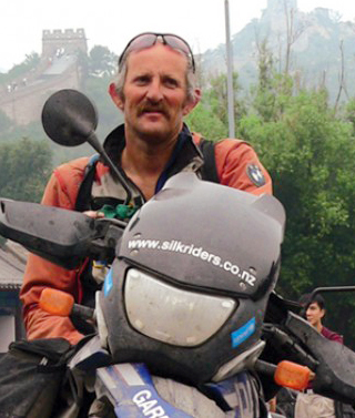 This picture from the blog of Gareth Morgan shows him posing for a photo during his motorcycle travels in China in 2005. (Yonhap News)