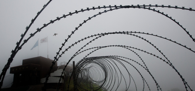 A South Korean guard post is seen behind a barbed wire fence in the Demilitarized Zone. (Yonhap News)