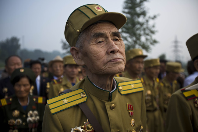North Korean veterans of the Korean War enter a cemetery for Korean War veterans on Thursday, July 25, 2013 in Pyongyang, North Korea during an opening ceremony marking the 60th anniversary of the signing of the armistice that ended hostilities on the Korean peninsula. (AP-Yonhap News)