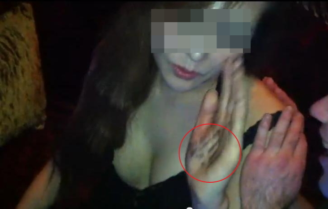 The Korea Herald recently obtained two videos from a person claiming to have participated in creating the controversial viral video of two Western men sexually harassing a Korean woman. This footage from one of the new videos shows that the woman has words, which may be lines from the script, written on her hand.