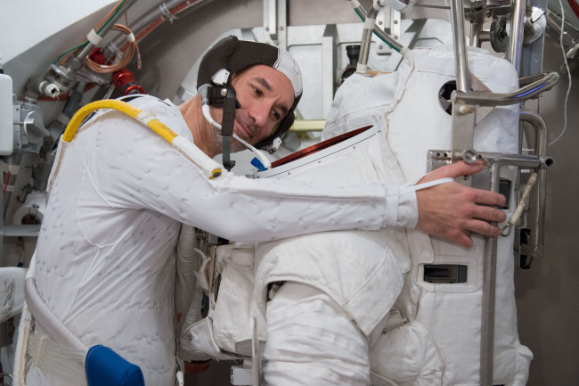 European Space Agency astronaut Luca Parmitano participates in a spacesuit fit check. (AP-Yonhap News)