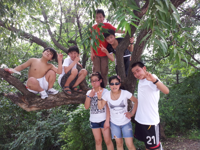 """The """"Laos Nine"""" on an outing in Dandong, China, in September 2012 (Park Sun-young)"""