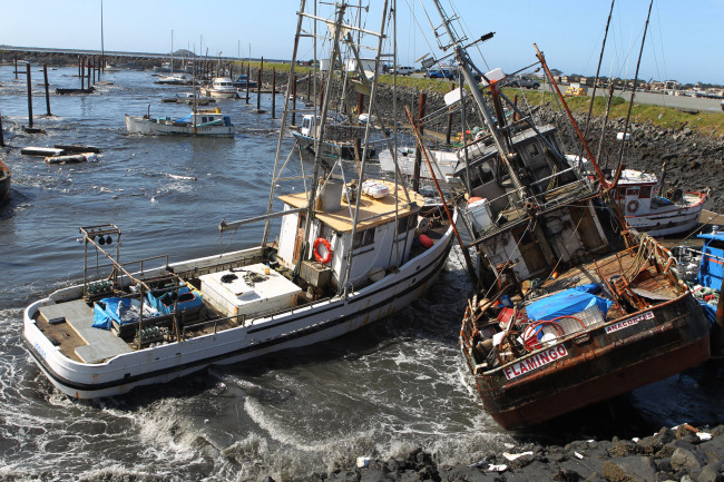 This 2011 file photo shows boats colliding with one another after a tsunami swept through Crescent City, California. (AP-Yonhap News)