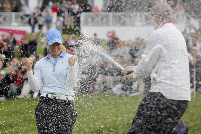Suzann Pettersen is sprayed with champagne after her win on Sunday. (AP-Yonhap News)