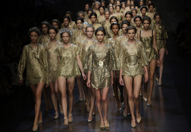 Models wear creations from Dolce & Gabbana women's Spring-Summer 2014 collection as part of the Milan Fashion Week in Milan on Sunday. (AP-Yonhap News)