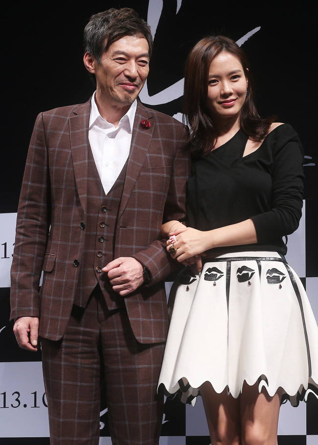 Actress Son Ye-Jin and actor Kim Kap-soo pose for a photograph during a press conference for her latest film