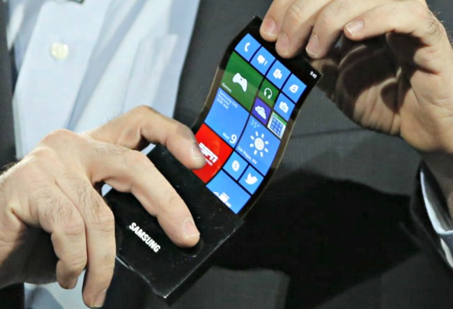 A U.S. businessman showcases Samsung Electronics' flexible OLED display YOUM during the CES 2013 in Las Vegas. (AP)