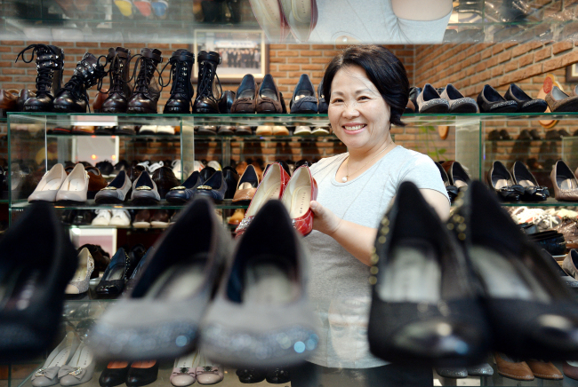 Park Dong-hee, chairwoman of Seongsu Sujehwa Town, poses for a photograph. The SSST is a joint store where 25 factories come together to sell their individual handmade shoe brands. (Ahn Hoon/The Korea Herald)