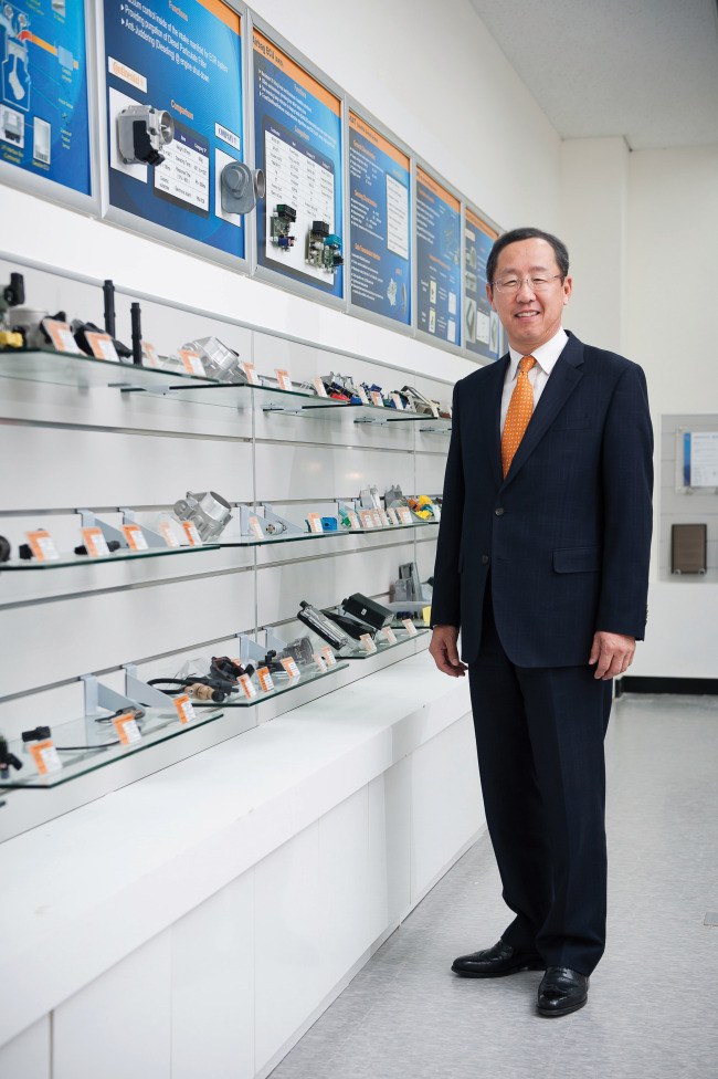 Sunwoo Hyun, CEO of Continental Automotive Systems Korea, poses with company products.(Continental Automotive)