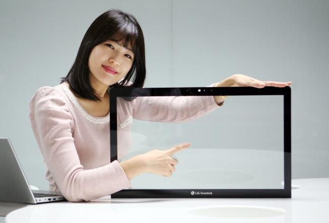 An LG Innotek employee poses with the Metal Mesh, a touch screen panel that has been optimized for larger panels such as laptops and desktop monitors. (LG Innotek)