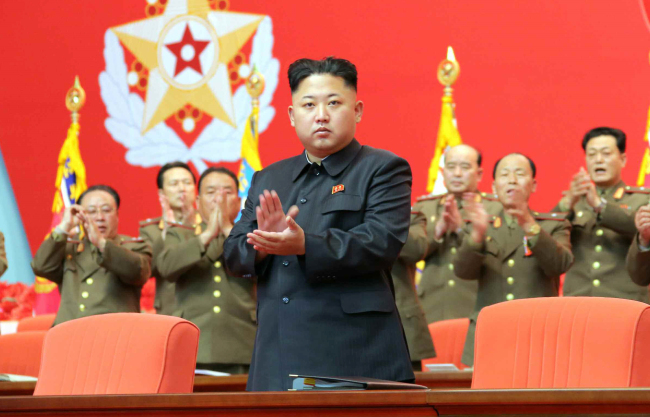 North Korean leader Kim Jong-un claps at the first conference of the military's security personnel to be held in 20 years in Pyongyang on Tuesday. (Yonhap News)