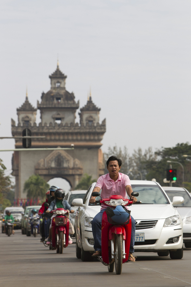 Traffic travels past the Victory Monument in Vientiane, Laos. (Bloomberg)
