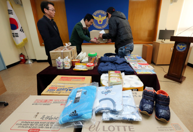 Goods that people sent to parents caught stealing to feed their baby are piled up in the Dongbu Police Station in Gwangju on Tuesday. (Yonhap News)