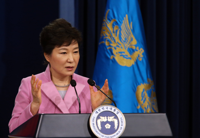 President Park Geun-hye answers a reporter's question during a press conference at Cheong Wa Dae on Monday. (Yonhap News)