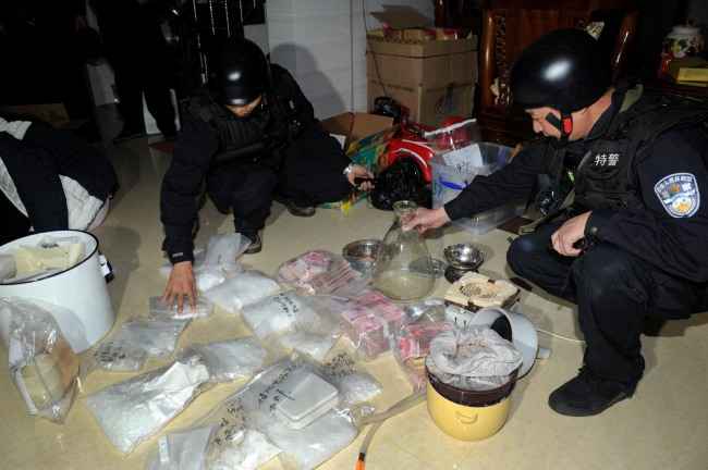 "Police inspect the seized crystal meth, or ""ice,"" in Boshe Village in the city of Lufeng, south China's Guangdong province. (Xinhua-Yonhap News)"