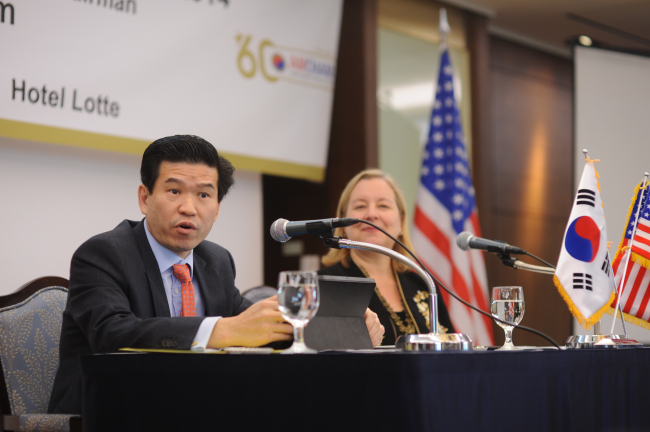 James Kim (left), chairman of the American Chamber of Commerce in Korea and Country Manager of Microsoft Korea, speaks alongside Amy Jackson, president of AMCHAM Korea, in a news conference in Seoul on Wednesday. (AMCHAM)