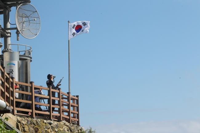 A police officer stands guard on Dokdo. (The Korea Herald file photo)