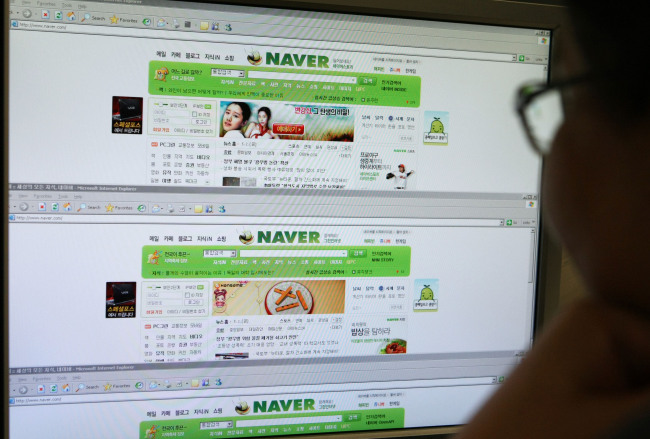 A man looks at NHN Corp.'s Naver homepage. (Bloomberg)