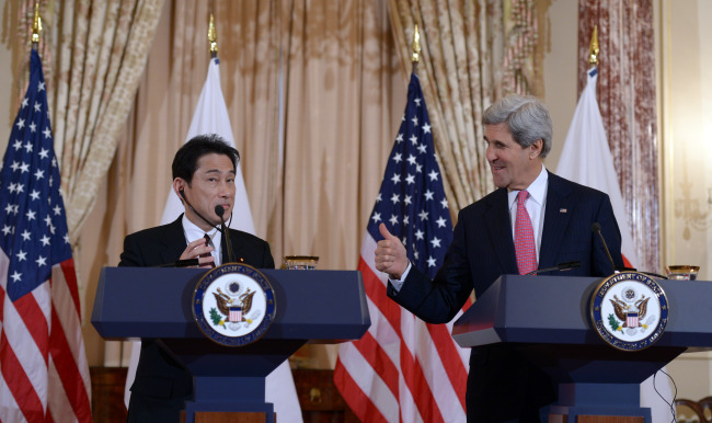 U.S. Secretary of State John Kerry (R) and Japanese Foreign Minister Fumio Kishida deliver remarks to media after their meeting at the Department of State in Washington D.C., the United States, Feb. 7, 2014. Kerry on Friday reaffirmed U.S. treaty obligations to Japan, vowing to maintain the prosperity and stability in Asia Pacific. (AP-Yonhap)