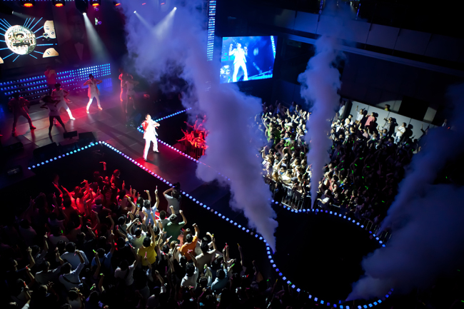 """Singer Psy performs at the Atrium performance hall in the lobby of POSCO Center in southern Seoul in July 2012 after the release of his hit single ''Gangnam Style."""" (POSCO)"""