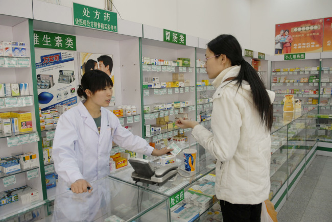 A shopper browses through a pharmacy in Beijing. (Bloomberg)