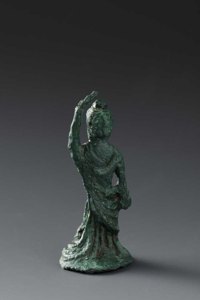 Standing just 6 centimeters tall, this bronze statue is presumed to be of Queen Maya, the mother of Buddha. (Buyeo National Research Institute of Cultural Heritage)