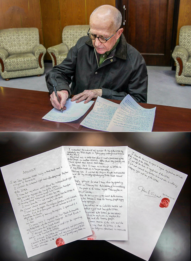 In this photo taken Saturday and provided by the Korean Central News Agency, John Short, an Australian missionary detained for spreading Christianity in North Korea, signs a written apology at an unknown location in North Korea. (Yonhap)