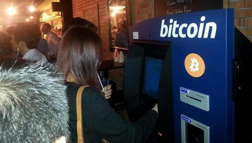 Singapore's first machine that can accept bitcoins in return for cash opened at Bartini Kitchen on Boon Tat Street on Monday. (The Straits Times)