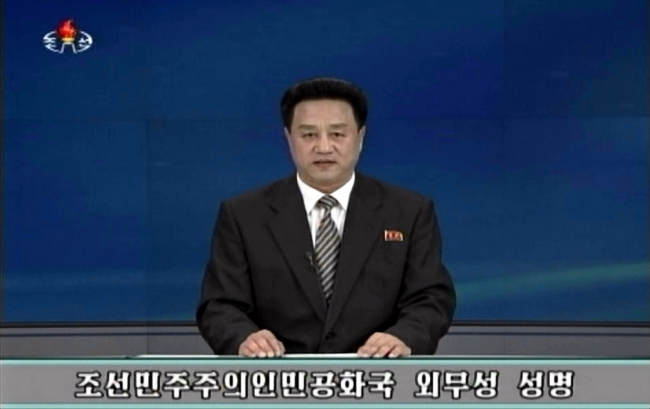 A North Korean TV announcer delivers a statement issued by the North's Foreign Ministry on Sunday. (Yonhap)