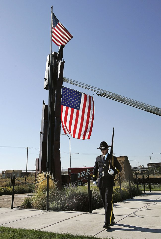 A member of the Fraternal Order of Police Honor Guard patrols on Sept. 11, 2013, at the 9/11 Memorial in Kennewick, Washington. (Richard Dickin/Tri-City Herald/MCT)
