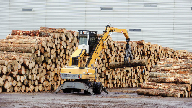 Logs are stacked ready for export at CentrePort in Wellington, New Zealand. (Bloomberg)