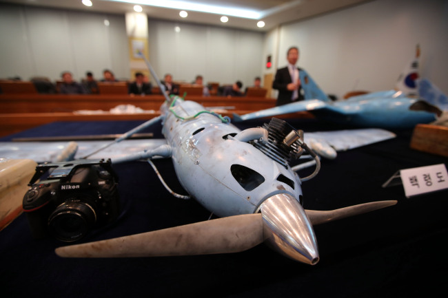 The Agency for Defense Development announces the interim results of its probe into three drones, presumably from North Korea, at the agency in Daejeon on Friday. (Joint Press Corps)