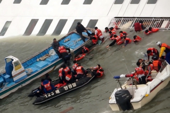 Navy rescuing the passengers who jumped off the ferry
