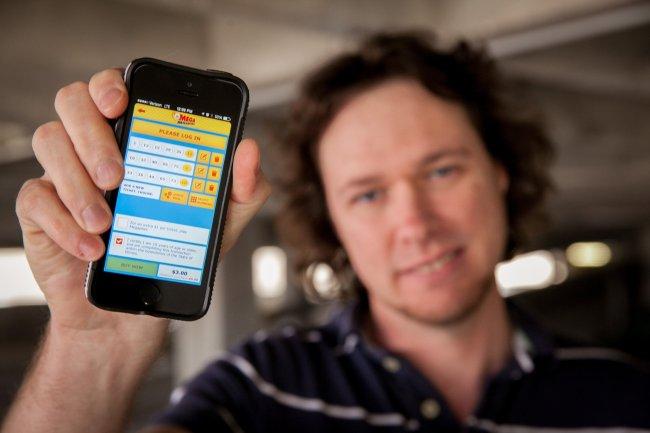 Matt Ruder shows the Illinois Lottery app on his smartphone in Peoria, Illinois, April 7. (Chicago Tribune/MCT)