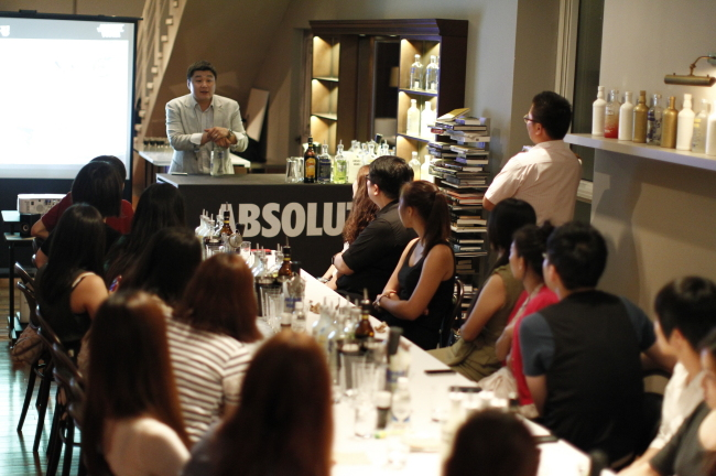 Participants learn cocktail-making during a mixology class offered by Absolut Vodka. (Pernod Ricard Korea)