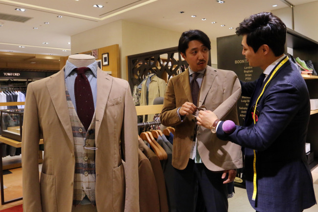 A customer checks a suit jacket at Shinsegae Department Store in southern Seoul. (Shinsegae Department Store)