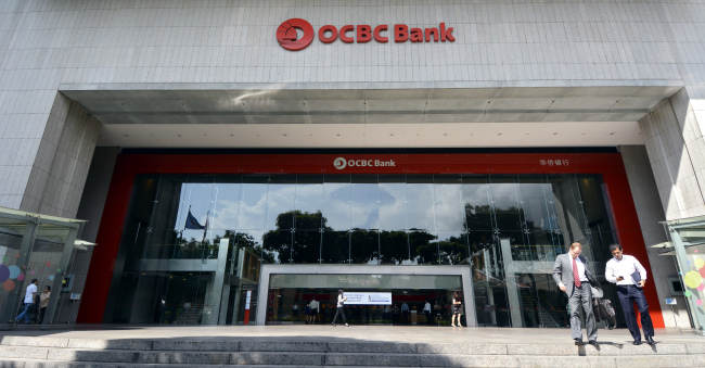 Signage for Oversea-Chinese Banking Corp. ( Bloomberg)