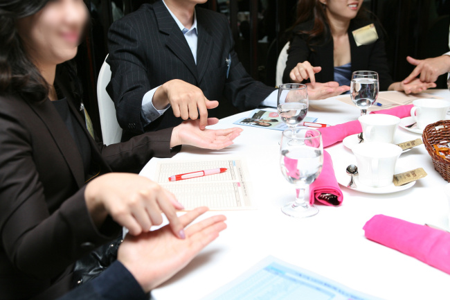 Members of a matchmaking agency attend a networking session. (Duo Info Corp.)