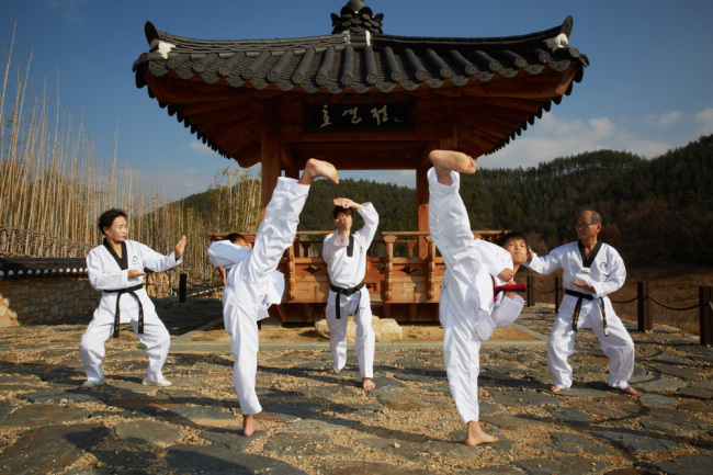 Taekwondo players practice on the Taekwondowon grounds in Muju, North Jeolla Province. (Courtesy of Taekwondowon)