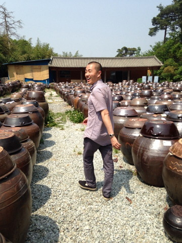 Chef Corey Lee walks among rows of jars containing jang in Sunchang, North Jeolla Province, Thursday. (Lucia Cho/Bicena)